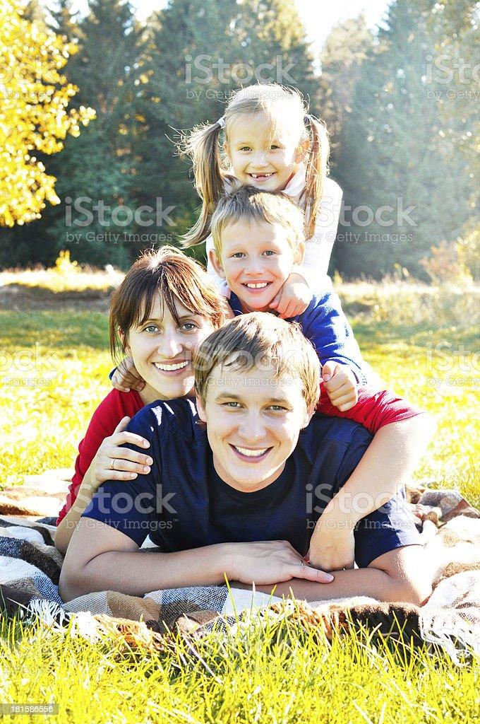 Happy family enjoying in warm autumn royalty-free stock photo