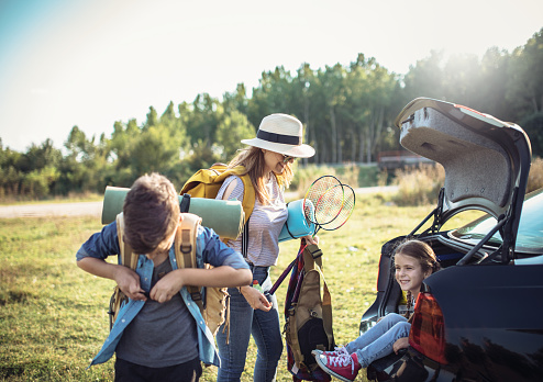 Happy Family  Enjoying picnic and Camping Holiday In Countryside