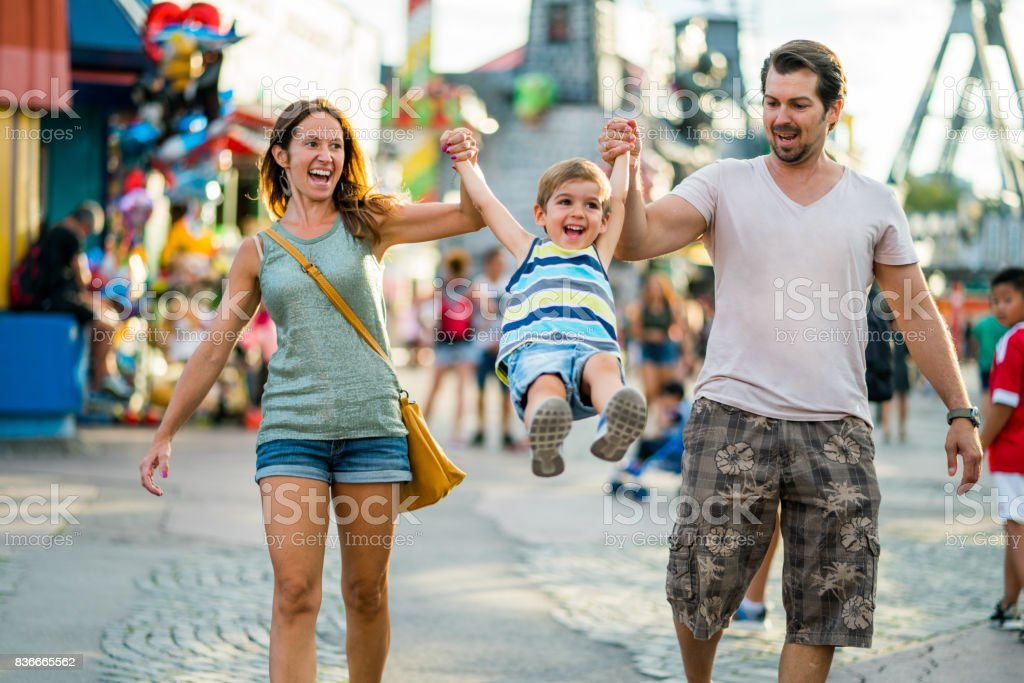 happy family enjoying summer day in amusement park stock photo