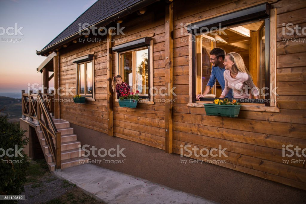 Happy family enjoying the weekend in the chalet. royalty-free stock photo