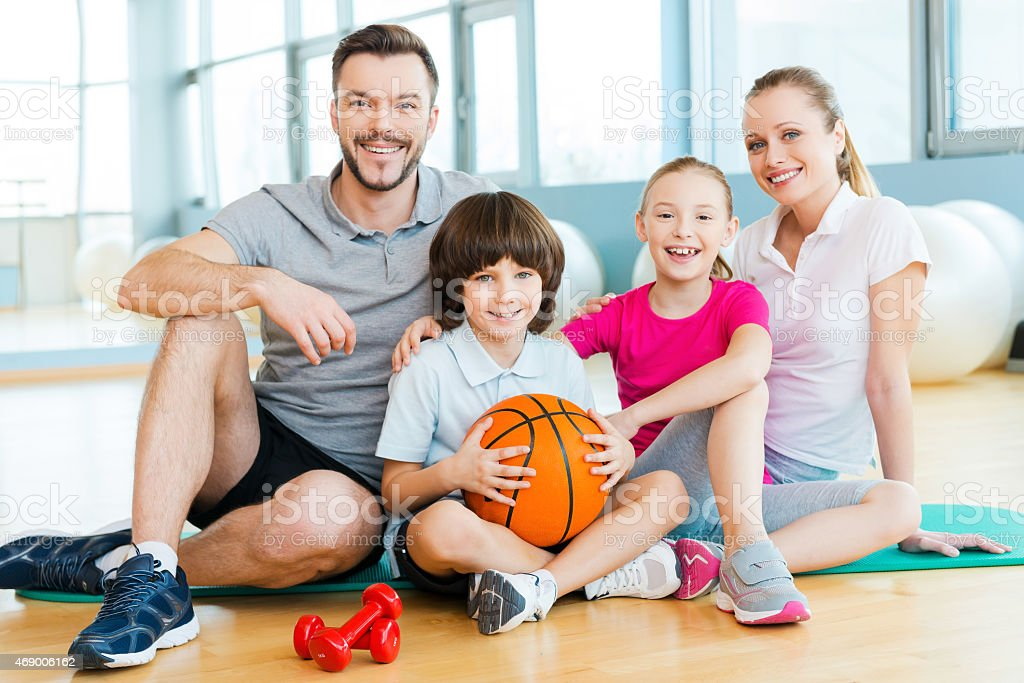 Happy family enjoying their day of fitness stock photo
