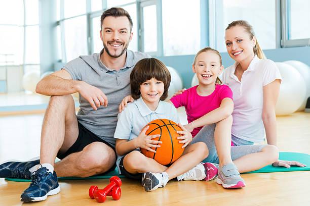 Happy family enjoying their day of fitness stock photo