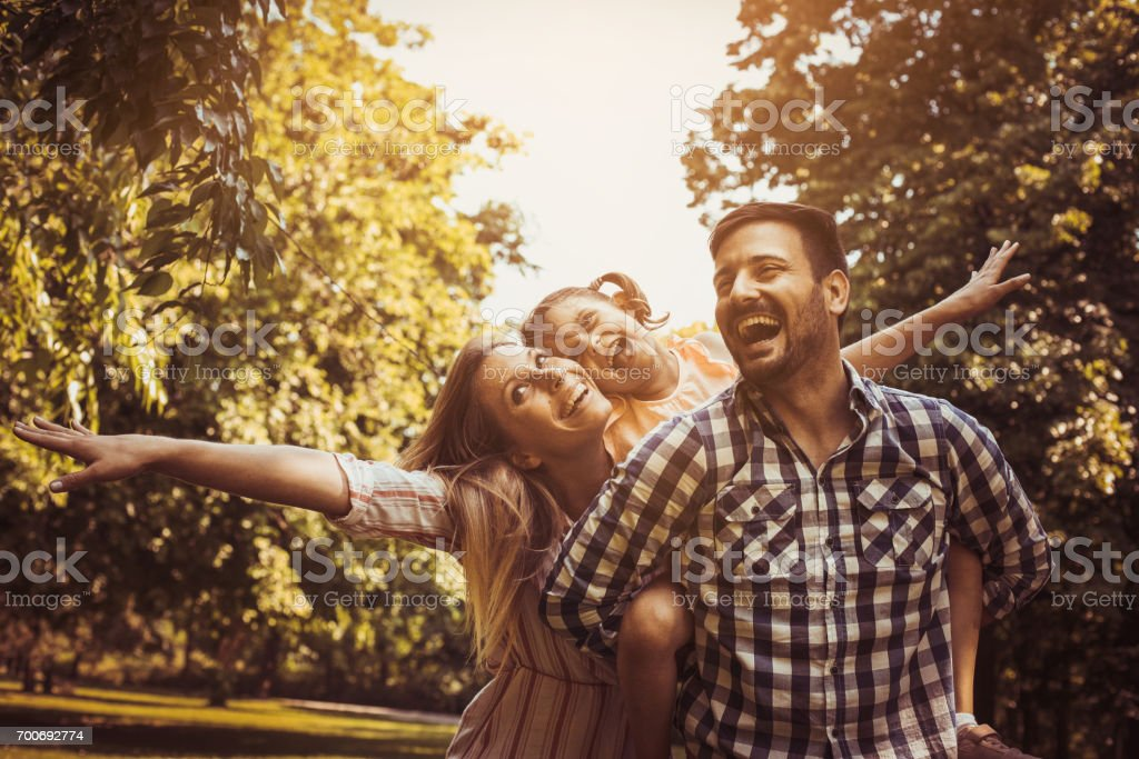Happy family enjoying together in summer day. Family in nature. stock photo