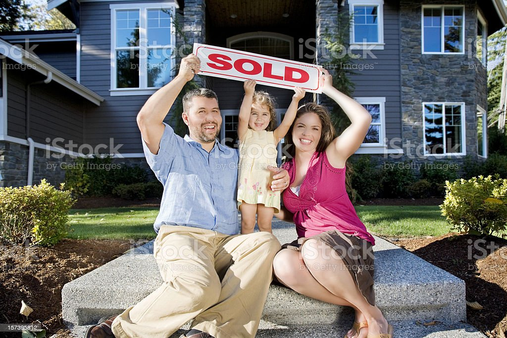 Happy family excited about their new home stock photo