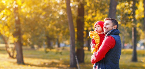 happy family father and baby son on   autumn walk stock photo