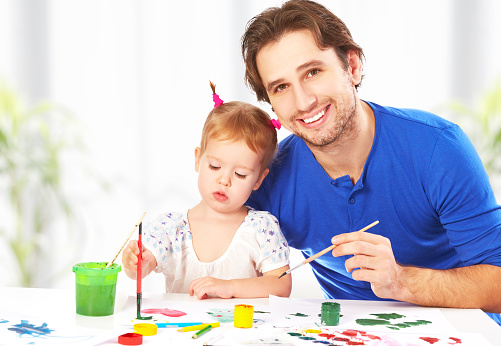1019302738 istock photo happy family father and child  daughter together draw paints 527495063