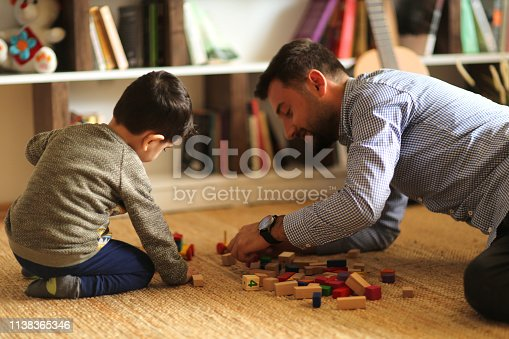 540396126istockphoto Happy family father and child son playing 1138365346