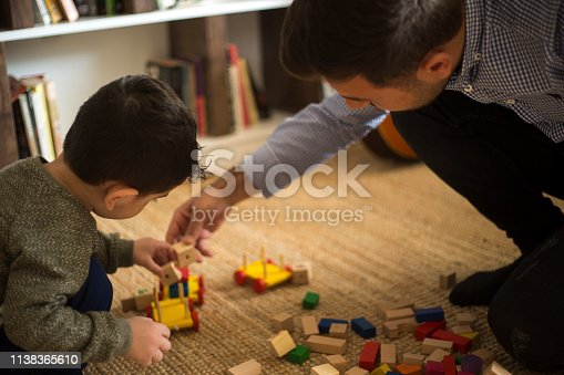 540396126istockphoto Happy family father and child son playing 1138365610