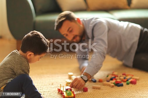 540396126istockphoto Happy family father and child son playing 1138365681