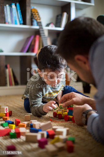 184659330 istock photo Happy family father and child son playing 1138365784