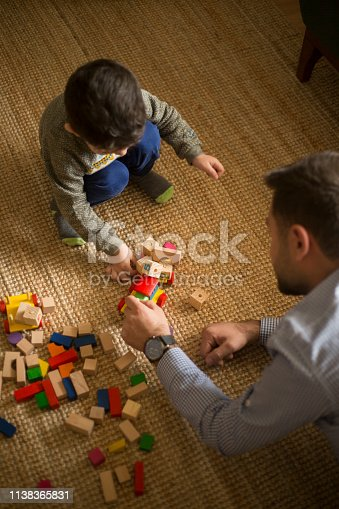 184659330 istock photo Happy family father and child son playing 1138365831