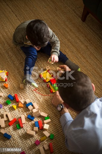 540396126istockphoto Happy family father and child son playing 1138365834
