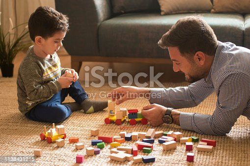 540396126istockphoto Happy family father and child son playing 1138431215
