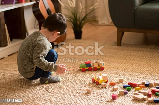 184659330 istock photo Happy family father and child son playing 1138431603
