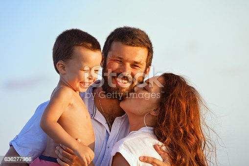 497142294 istock photo Happy family - father, mother, baby on sunset beach 636277986