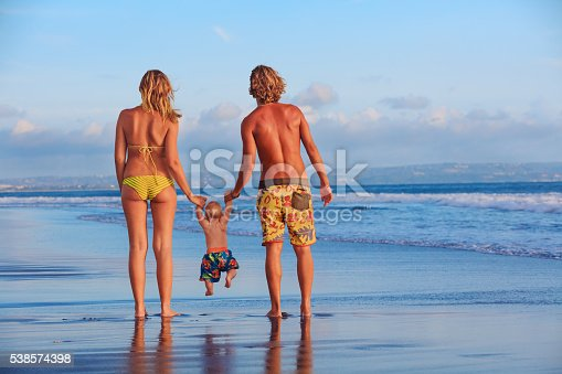 497142294 istock photo Happy family. Father, mother, baby son on sea beach holiday 538574398
