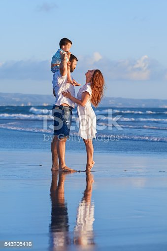 583830686istockphoto Happy family father, mother, baby son on sea beach holiday 543205416