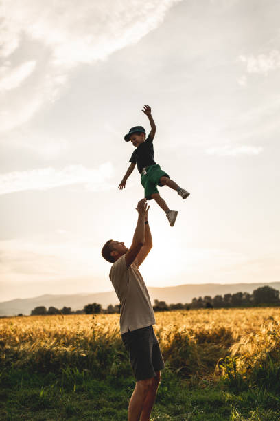 Happy family, father playing with son stock photo