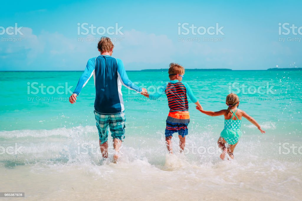 happy family -father with kids play with water run on beach royalty-free stock photo