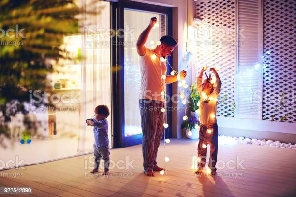 Happy family father with sons decorate open space patio area with picture id922542890?b=1&k=6&m=922542890&s=612x612&h=nuyprfh5ldzakbso39ulpywmfdv1rqsbqjo z rpbn4=