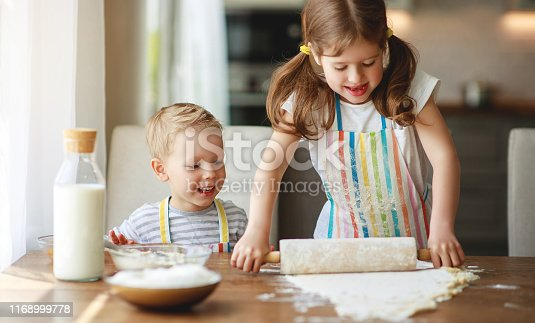 664420980 istock photo happy family funny kids bake cookies in kitchen. 1168999778