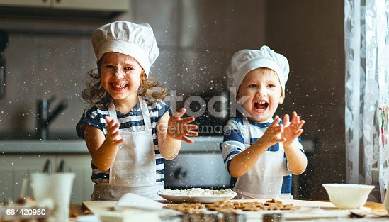 istock happy family funny kids bake cookies in kitchen 664420980
