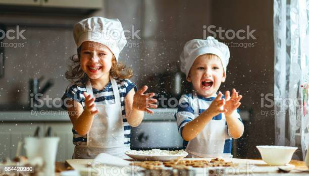 Happy family funny kids bake cookies in kitchen picture id664420980?b=1&k=6&m=664420980&s=612x612&h=4gyqu5efla15lscsrsjjmd oln2mb5ihkefzfvrxfvk=