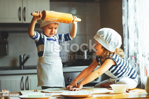 664420980 istock photo happy family funny kids bake cookies in kitchen 666064548