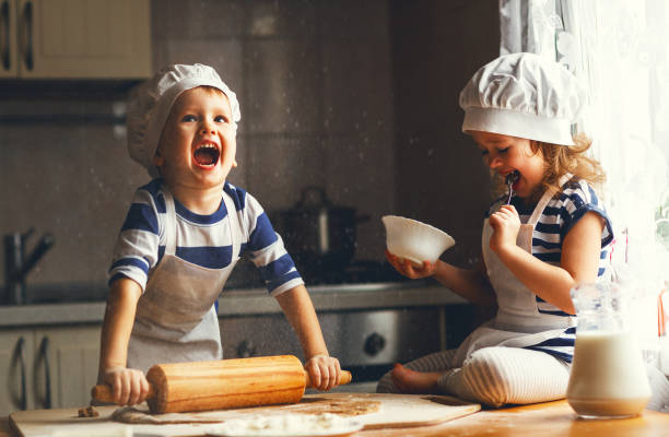 happy family funny kids bake cookies in kitchen - foto stock