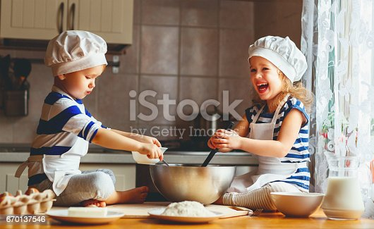 664420980 istock photo happy family funny kids bake cookies in kitchen 670137546