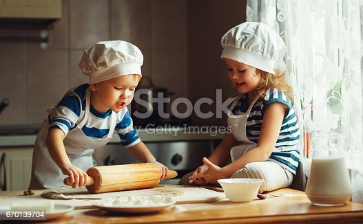 664420980 istock photo happy family funny kids bake cookies in kitchen 670139704