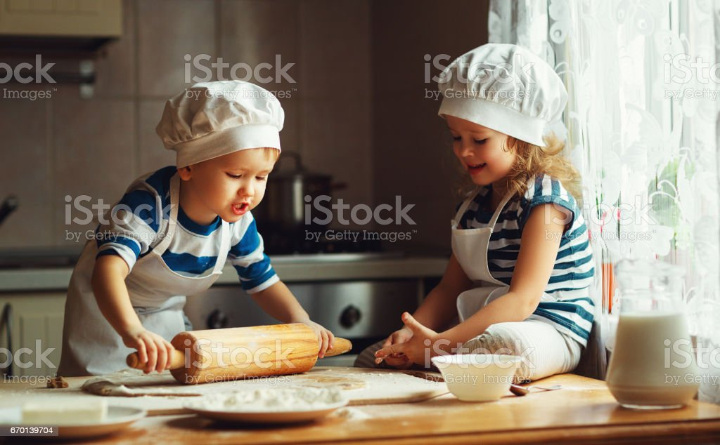 happy family funny kids bake cookies in kitchen - Photo