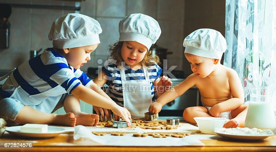 664420980 istock photo happy family funny kids bake cookies in kitchen 672824576