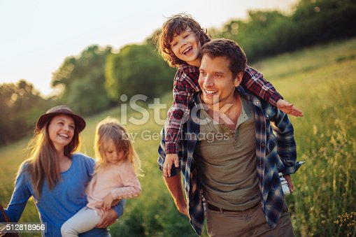 istock Happy family going for picnic 512818956