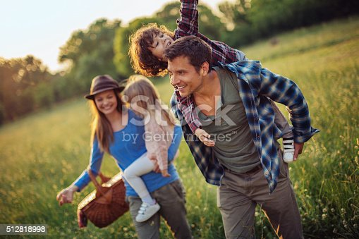 istock Happy family going for picnic 512818998