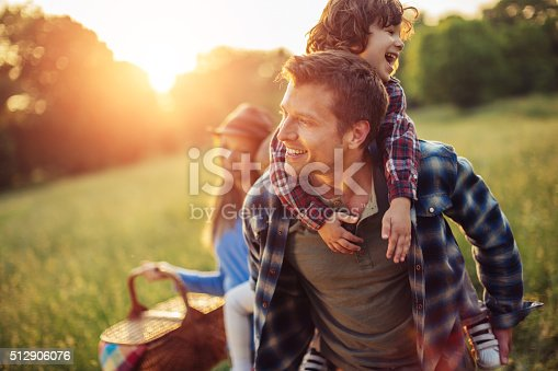 istock Happy family going for picnic 512906076