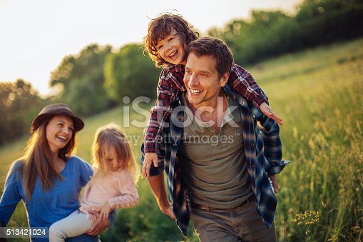 istock Happy family going for picnic 513421024