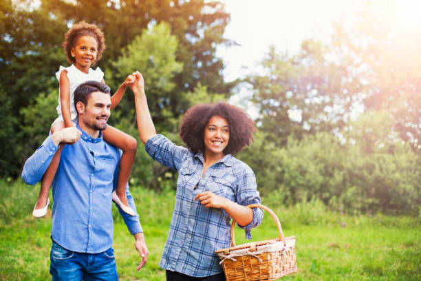 Happy family going for picnic stock photo