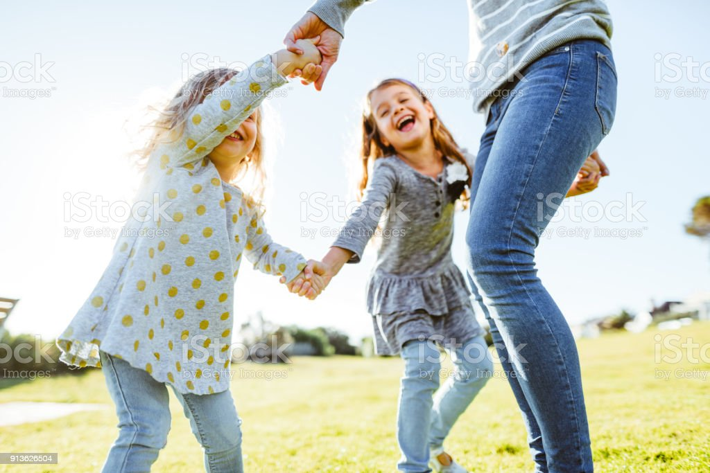happy family have fun in the park stock photo