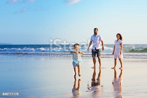 497142294 istock photo Happy family have fun on sunset beach 846711176