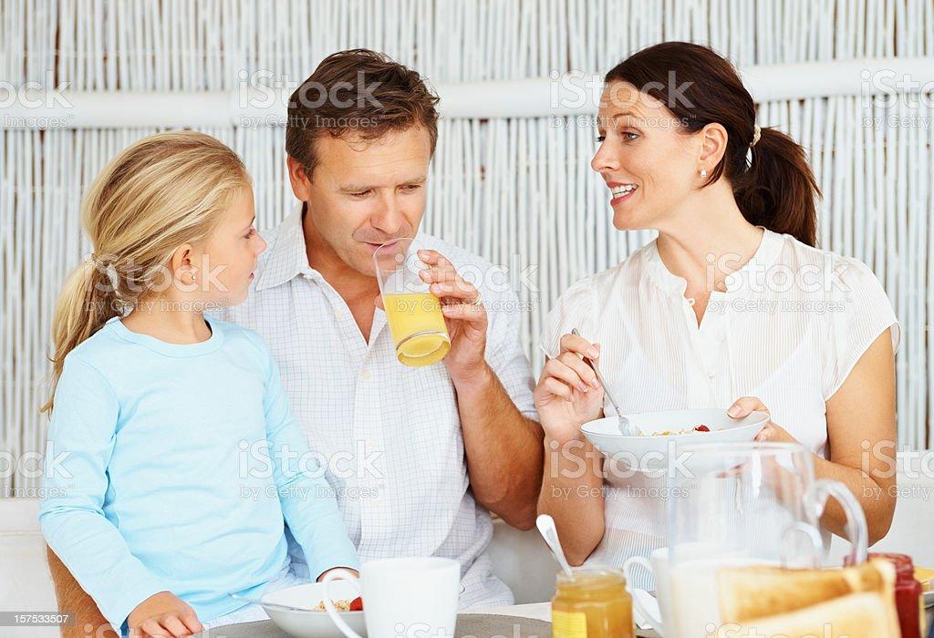 Happy family having a breakfast royalty-free stock photo