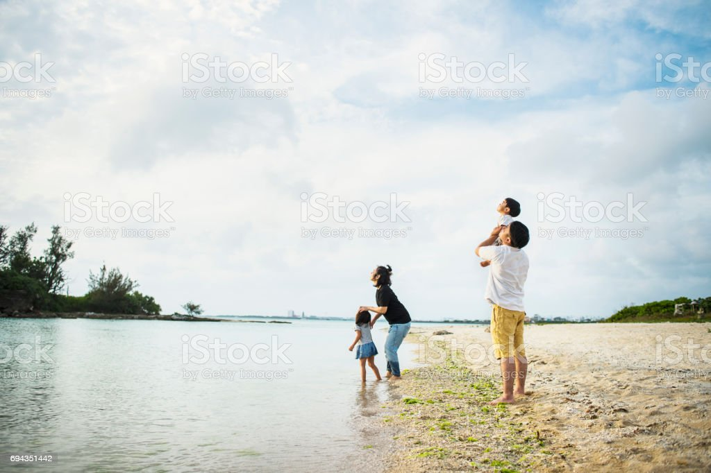 Happy family having a good time in beach. stock photo