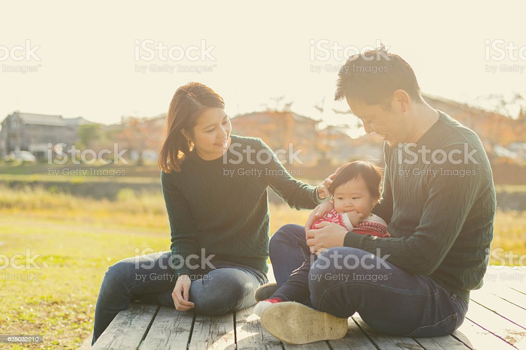 Happy family having a good time with baby girl stock photo