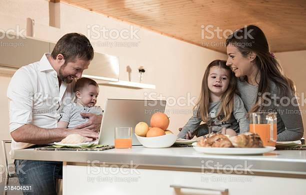 Happy Family Having Breakfast Stock Photo - Download Image Now