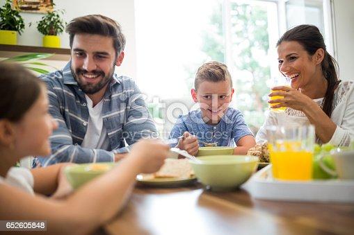 istock Happy family having breakfast 652605848