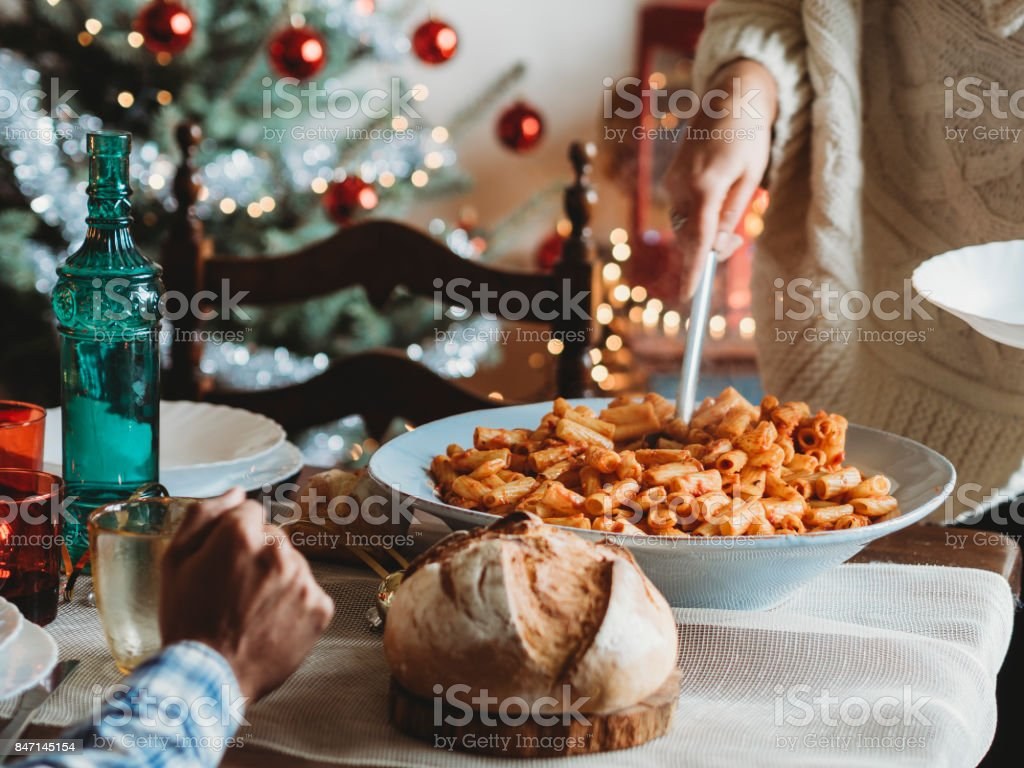 Happy family having Christmas lunch together stock photo