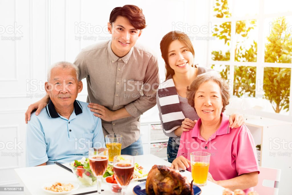 Happy family having dinner together stock photo