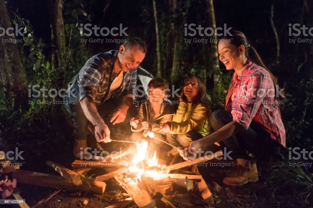 Happy family having fun camping stock photo
