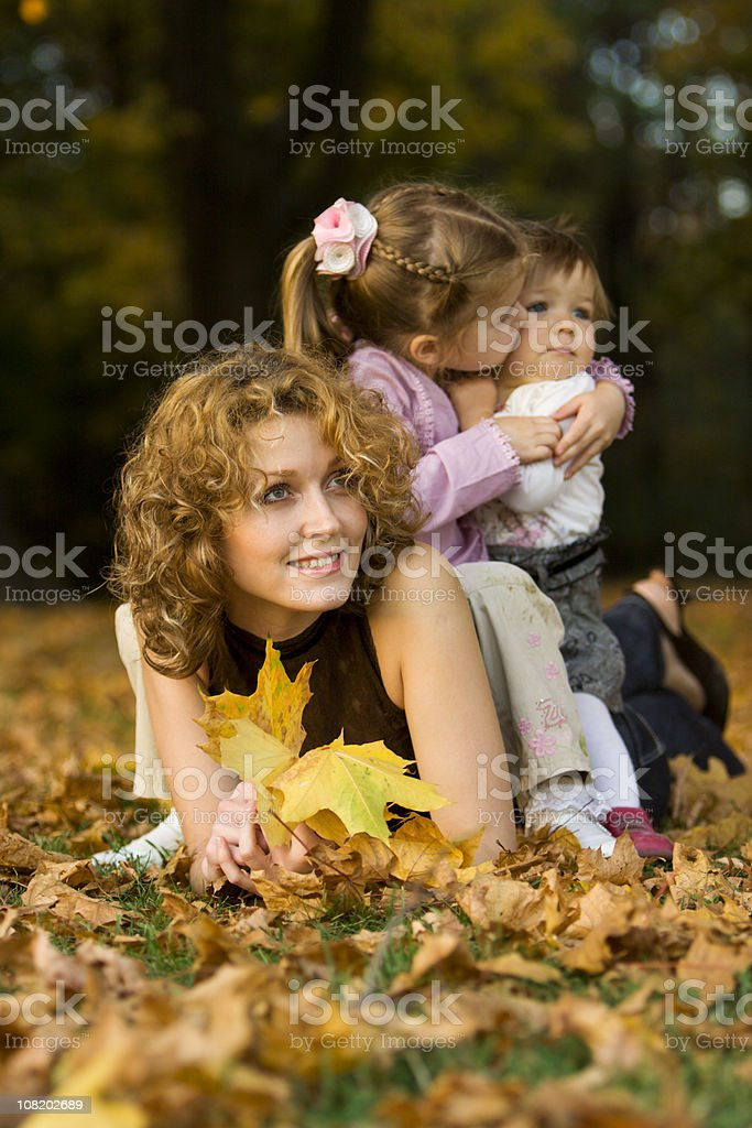 Happy family having fun in autumn park royalty-free stock photo