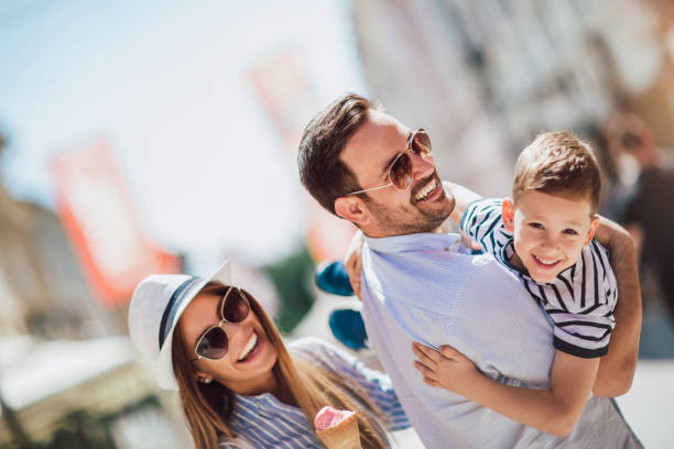 Happy family having fun outdoor after shopping Happy family having fun outdoor after shopping affluent lifestyles stock pictures, royalty-free photos & images